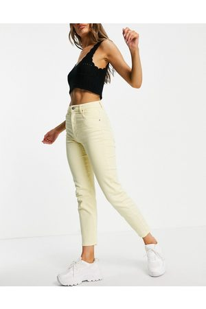 Stradivarius Slim mom jean with stretch in yellow