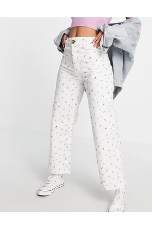 Stradivarius Floral cropped wide leg jean in white