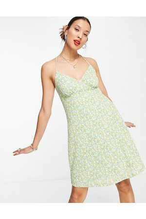 ONLY Mini sundress with cross back in ditsy green floral