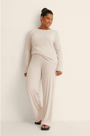 NA-KD Dame Wide Leg - Resirkulerte Vide Jeans Med Myke Ribber
