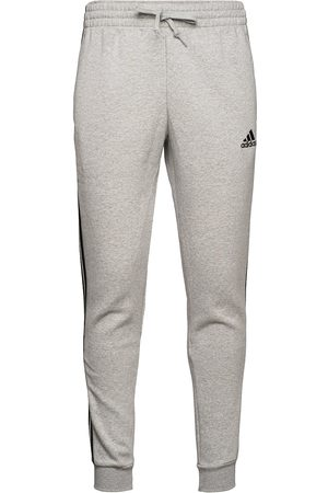 adidas Essentials Fleece Fitted 3-Stripes Pants Joggebukser Pysjbukser Grå
