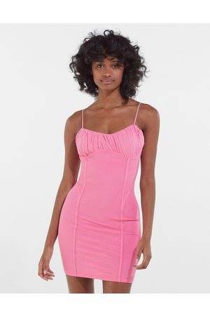 Bershka Strappy mesh bodycon dress with ruching in pink