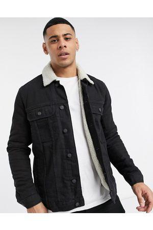 ASOS DESIGN Denim jacket with ecru borg lining in black