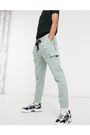 ASOS Unrvlld Spply Oversized tapered jogger-Green