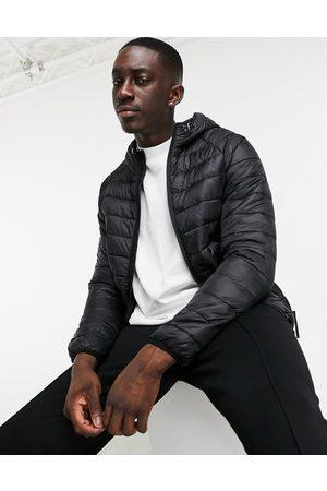 Bershka Padded puffer jacket with hood in black