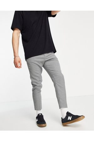 ASOS DESIGN Tapered crop suit trousers in library check-Grey