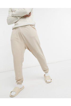 ASOS DESIGN Super soft viscose drop crotch joggers in -Neutral