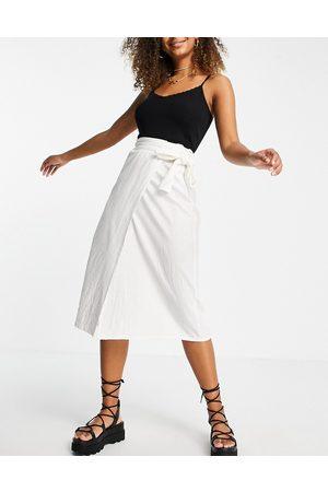 ASOS DESIGN Wrap midaxi skirt with wrap around tie detail in white