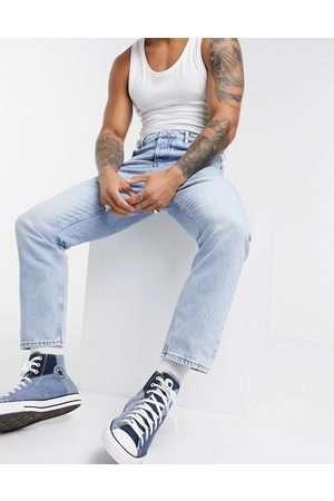 ASOS Relaxed tapered jeans in light blue stone wash