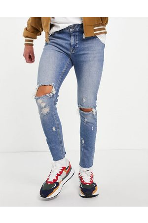 ASOS Skinny jeans in mid wash with knee rips and raw hem-Blue