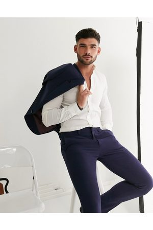 ASOS Super skinny suit trousers in four way stretch in navy