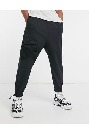 ASOS Oversized tapered joggers with cargo pockets in black