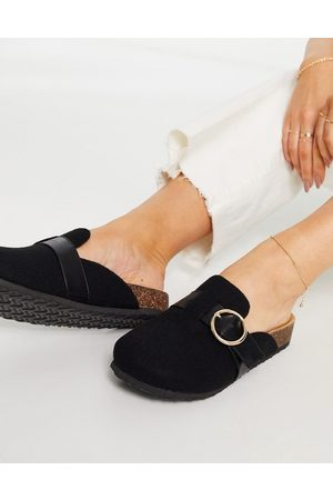ASOS Musa footbed closed toe flat shoes in black
