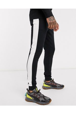 ASOS Organic skinny joggers with side stripe in black