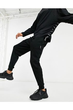 ASOS Unrvlld Spply Tapered joggers in black waffle