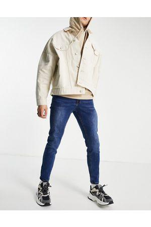 New Look Herre Skinny - Skinny jeans in mid blue