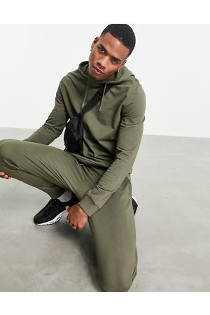 ASOS Organic lightweight tracksuit with hoodie & skinny joggers in green