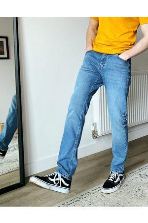 ASOS Slim jeans in mid wash blue