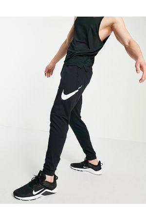 Nike Swoosh joggers in black