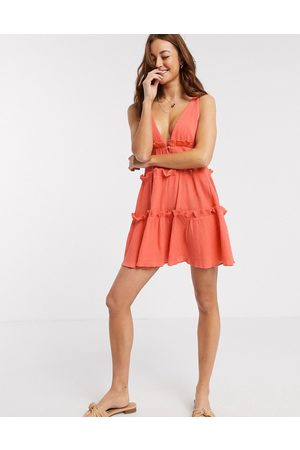 ASOS Button front tiered mini sundress in textured crinkle in coral-Pink