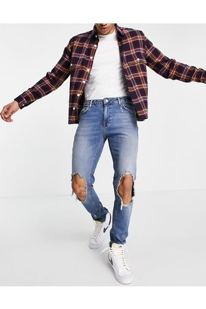 ASOS Skinny jeans in mid wash blue with extreme rips