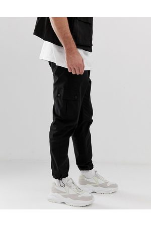 ASOS Tapered cargo trousers in black with toggles