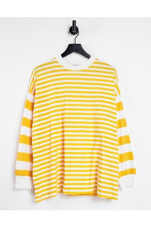ASOS Dame Langermede - Oversized long sleeve t-shirt with cutabout stripe in sunshine yellow