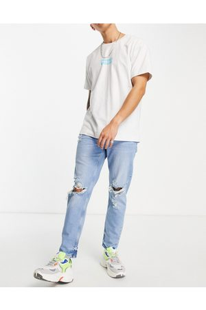 ASOS Herre Tapered - Tapered carrot jeans in light wash blue with knee rips