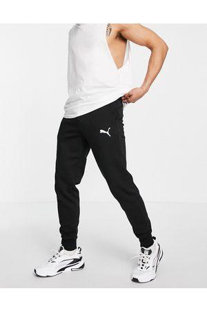 PUMA Essentials cat logo joggers in black