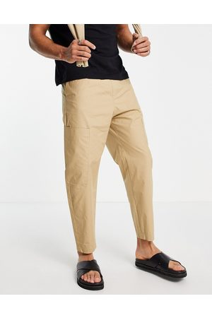 Bershka Loose fit lightweight trousers with pocket in -Neutral