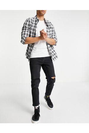 New Look Slim crop jeans with knee rips in black