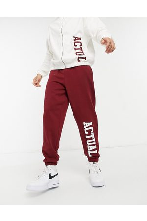ASOS Co-ord oversized joggers in burgundy with cream applique logo-Red