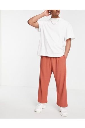 ASOS Co-ord oversized fixed hem joggers in rib texture-Pink