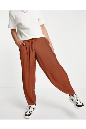 ASOS Oversized tapered smart trouser in rust plisse with elasticated waist-Brown