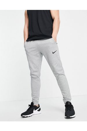 Nike Dri-FIT tapered joggers in light grey