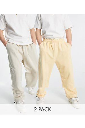 ASOS Organic super oversized joggers with toggle hem in oatmeal marl/pastel orange 2 pack-Multi