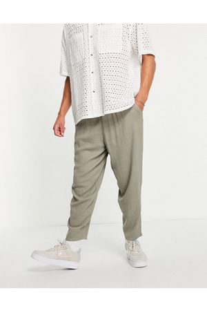 ASOS Oversized tapered lightweight trousers with elasticated waist in khaki-Green