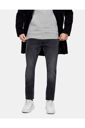 Topman Organic cotton blend slim jeans in washed black