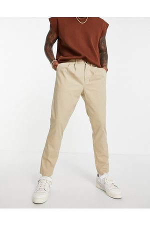 ASOS Cigarette chinos with pleats in -Neutral