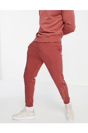 Topman Co-ord Signature embroidered jogger in burgundy