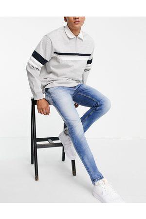 Tommy Hilfiger Austin slim fit jeans in light blue