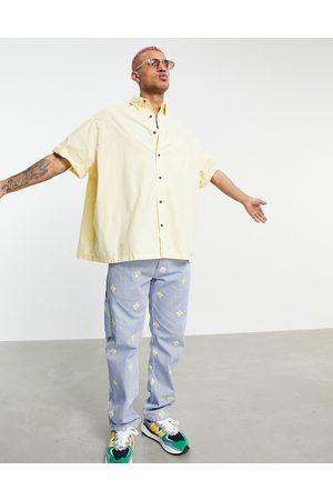 ASOS Extreme oversized short sleeve washed poplin shirt in lemon-Yellow