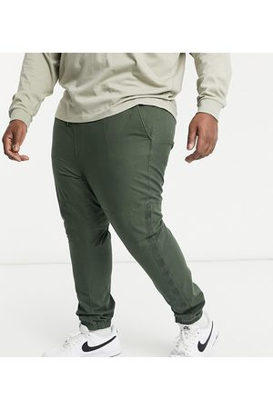 ASOS Plus tapered trousers with tape detailing in heavy wash in khaki-Green