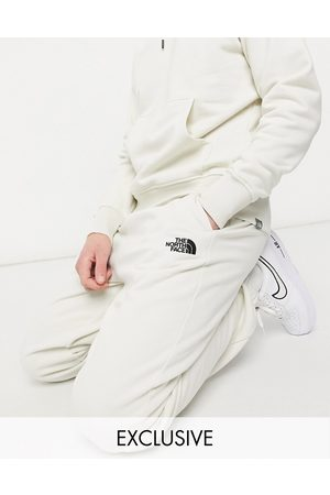 The North Face Oversized Essential joggers in cream Exclusive at ASOS-White