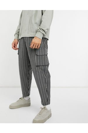 ASOS Oversized tapered cargo joggers in textured stripe-Black