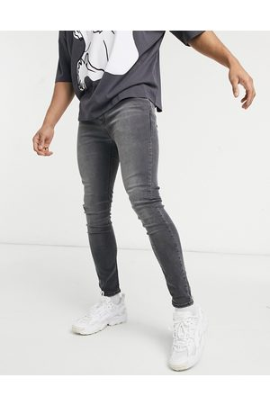 ASOS Spray on jeans with power stretch in washed black