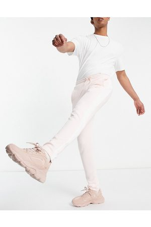 PUMA Summer Luxe T7 track bottoms in pink