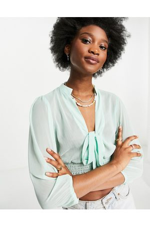 ASOS Dame Langermede - Sheer long sleeve top with shirred waist in mint-Green