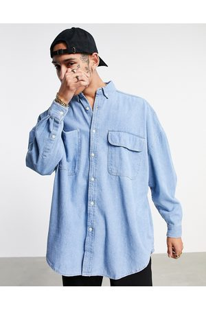 ASOS Oversized denim shirt in vintage mid wash blue