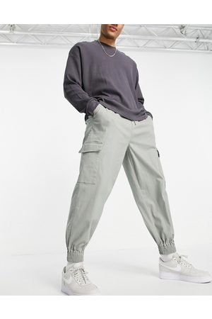 ASOS Oversized tapered trousers with cargo pockets in green